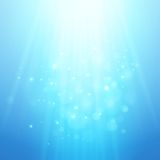 Blue rays of light. Vector bokeh blurred Stock Photo