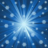 Blue rays and snowflakes Royalty Free Stock Photo