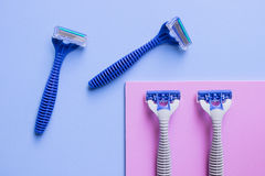 Blue razor. On blue background Royalty Free Stock Images