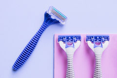 Blue razor. On blue background Royalty Free Stock Photo