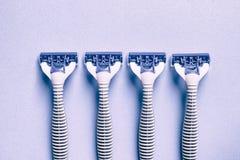 Blue razor. On blue background Royalty Free Stock Photo