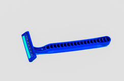 A blue razor. Is isolated on white background Royalty Free Stock Images