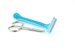Blue razors for woman and scissors Royalty Free Stock Image