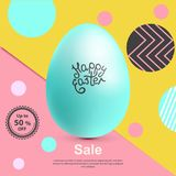 Blue realistic Easter egg on yellow pink abstract background. Minimalism.. Sale banner. Blue realistic Easter egg on yellow pink abstract background. Minimalism Royalty Free Stock Images