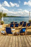 Blue recliner chairs on a tropical beach Stock Images