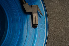 Blue record on turntable Royalty Free Stock Photos