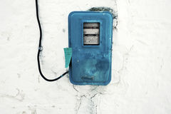 Blue Rectangular Electricity Meter Box on White Painted Wall Royalty Free Stock Photos