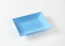 Blue rectangular plate. On white background Stock Images