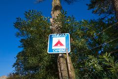 Sign of camping open in a tree Royalty Free Stock Image