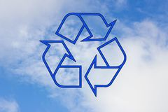 Blue recycle icon on the background of sky Stock Photography