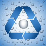 Blue recycle symbol on wet background. Water drop inside the sign Royalty Free Stock Photo