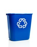 Blue recylcing bin on white. A blue recycling bin on a white background Royalty Free Stock Photos