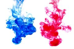 Blue and red. Flow of blue and red color paint in still water stock image