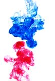 Blue and red. Flow of blue and red color paint in still water stock photography