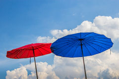 Blue and red beach umbrella Royalty Free Stock Photography