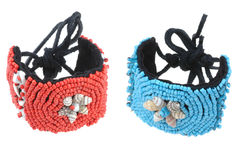 Blue and red beads bracelets isolated Stock Photos