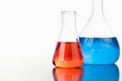 Blue and red beakers Royalty Free Stock Images