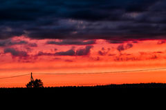 Blue, Red And Black. A dramatic sunset in the rural Finland royalty free stock photography