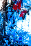 Blue, red and black  ink in water Stock Image