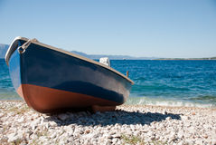 Blue-red boat on the beach Royalty Free Stock Image