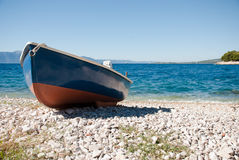 Blue-red boat on the beach Royalty Free Stock Images