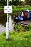Blue and red canal boat moored in the Forth & Clyde Canal, Scotl Royalty Free Stock Photos