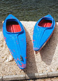 Blue and red  canoes (big and small) Royalty Free Stock Photos