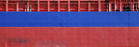 Blue and red cargo ship hull texture Royalty Free Stock Photo