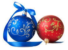 Blue and red christmas balls with ribbon. Bow on white background stock images