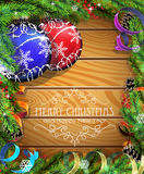 Blue and red Christmas balls on wooden background. Blue and red Christmas balls, cones, berries and fir tree branches on wooden background Royalty Free Stock Photo