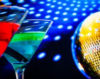 Blue and red cocktail with golden sparkling disco ball background selected focus Royalty Free Stock Photography