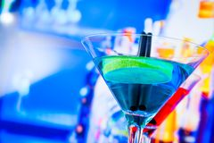 Blue and red cocktail with lounge bar background with space for text. Dance disco concept Royalty Free Stock Photography