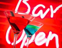 Blue and red cocktail with neon bar word background with space for text Royalty Free Stock Photos