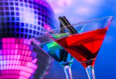 Blue and red cocktail with sparkling disco ball background with space for text Stock Image