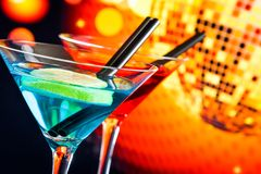 Blue and red cocktail with sparkling disco ball background with space for text royalty free stock photo