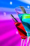 Blue and red cocktail with sparkling disco ball background with space for text selected focus Stock Photography