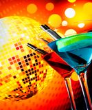Blue and red cocktail with sparkling disco ball background with space for text selected focus Royalty Free Stock Images