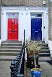 The blue and red door. Part of facade with red and blue door stock photos