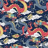Dragons on blue pattern. Blue and red dragons fighting in the clouds. Seamless pattern for textile and decoration Royalty Free Stock Images