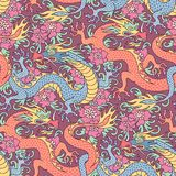 Dragons in flowers. Blue and red dragons fighting in flowers. Seamless pattern for textile and decoration Royalty Free Stock Image