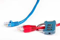 Blue and red ethernet cables and lock Stock Photos