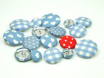 Blue and red fabric buttons isolated Stock Photo