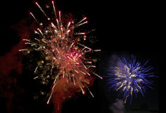 Blue and red firework Stock Images