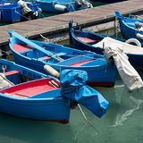 Fishing boats in a harbour. Blue and red fishing boats in harbour, south Italy Royalty Free Stock Images