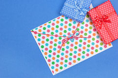 Blue and red gift boxes with envelope Royalty Free Stock Photos