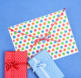 Blue and red gift boxes with envelope Stock Photos