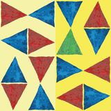 Blue,red and green watercolor triangles in fun abstract geometric design. Vector seamless pattern on striped yellow stock illustration