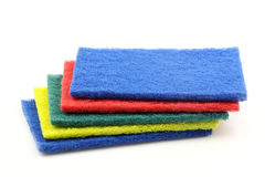 Blue, red, green and yellow abrasive pads royalty free stock photography