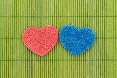 Blue and red hearts against bamboo sticks Royalty Free Stock Image