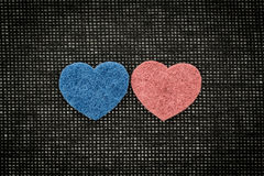 Blue and red hearts against a dark background Stock Image
